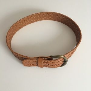 Cinch your waist with this woven leather belt